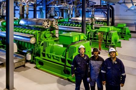 Clarke Energy service engineer with customer at the Tronox furnace gas CHP facility in South Africa
