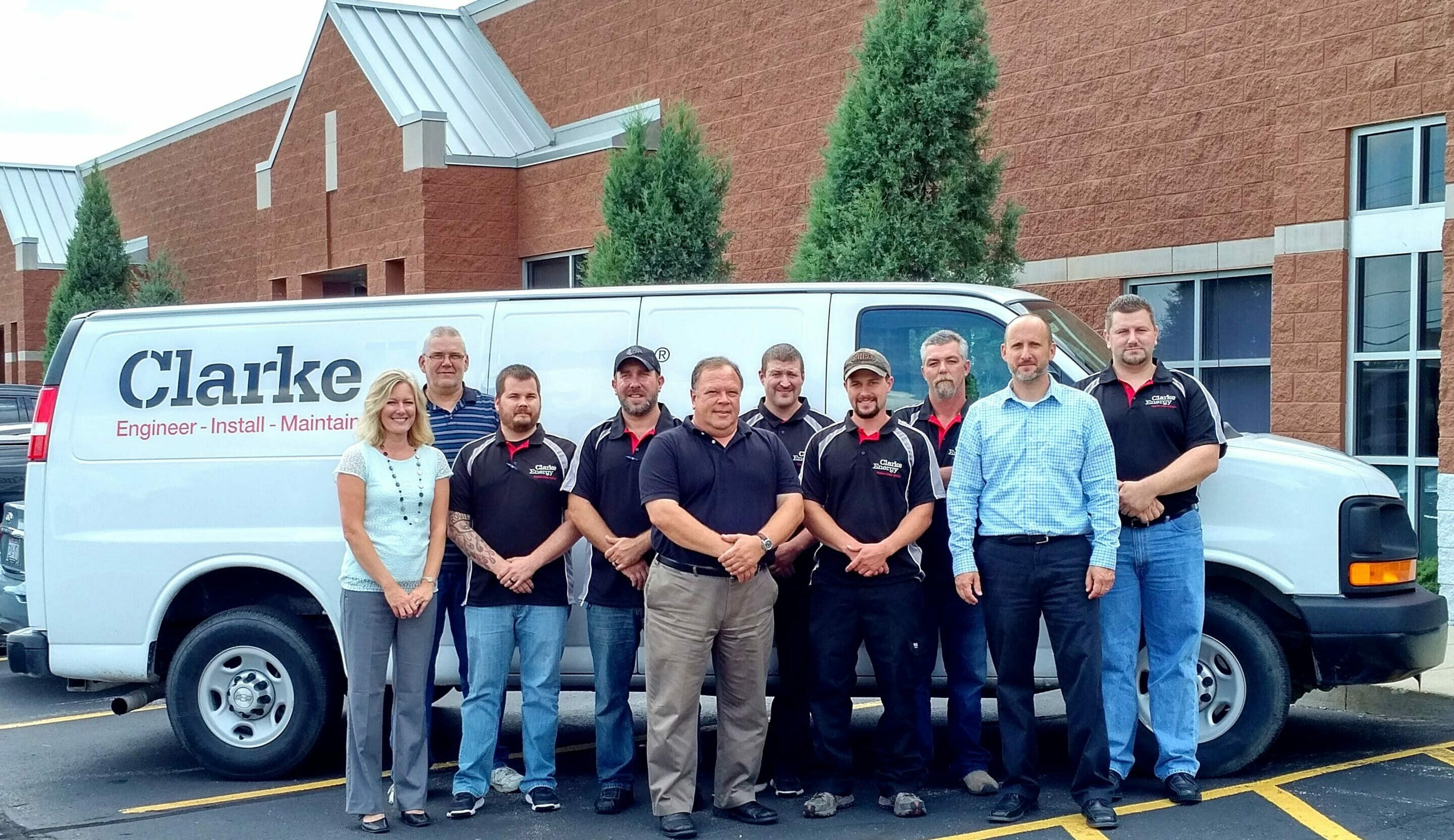 A photograph of the new members of Clarke Energy's US operations and a Clarke Energy service van