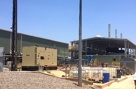 A photograph of the Tennant Creek power station including power house and Kohler diesel genset