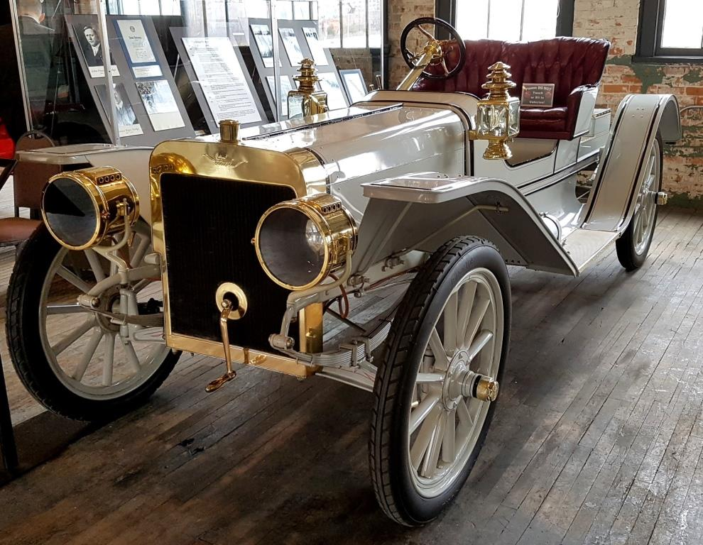 A photograph of a historic 1908 Ford Roadster at the Ford Piquette Avenue Plant