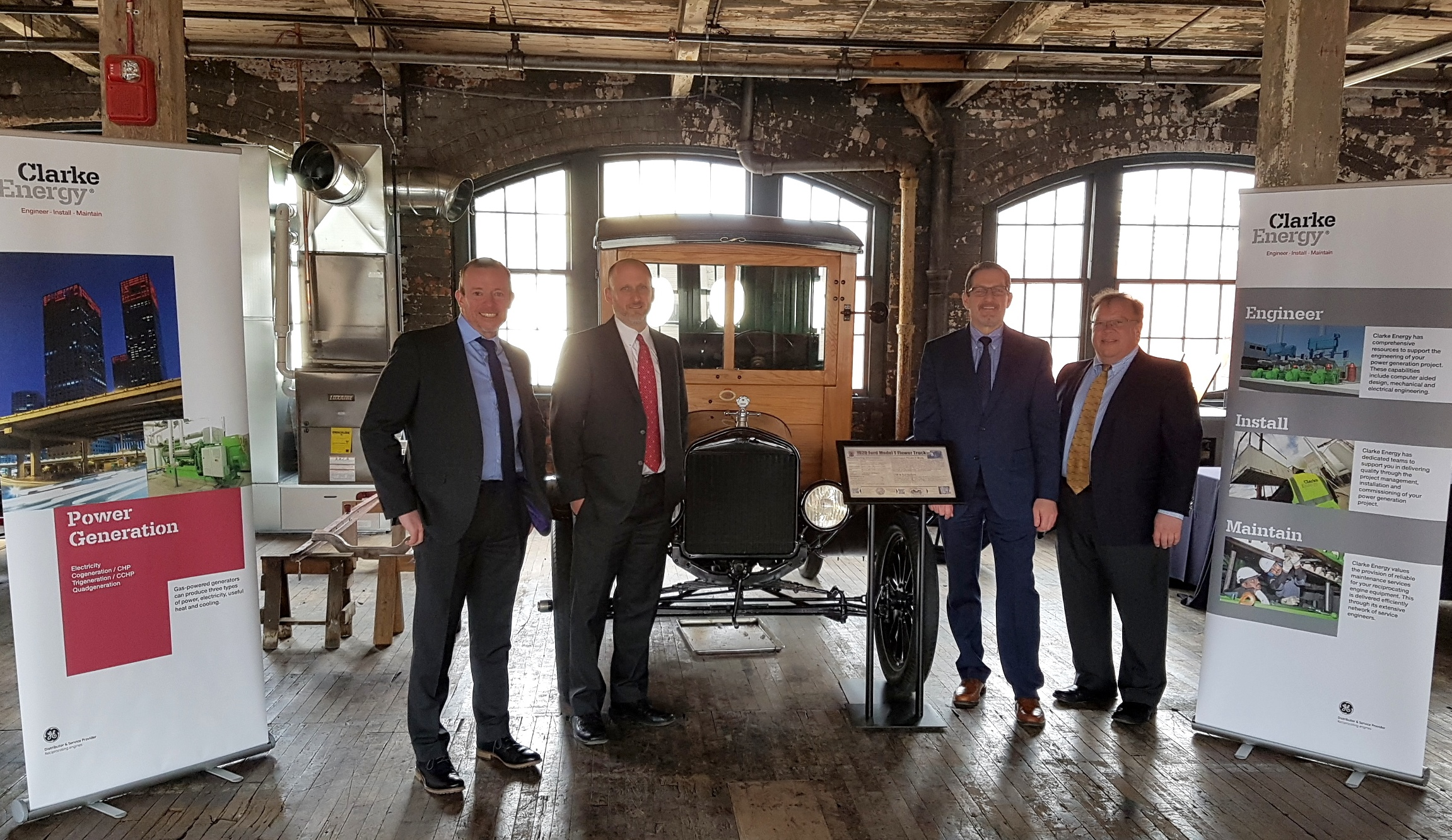A photograph of Clarke Energy's US team members (l-r Chris Hayhurst, Business Development Director, Jon Going, Sales Director, Chris Bixby, Sales Engineer, Charlie Mayer, Sales Engineer) and historic Ford motorcar