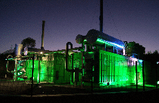 An illuminated landfill gas plant consisting of two containerised Jenbacher gas engines