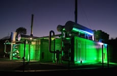 Two containerised landfill gas generators at night in France